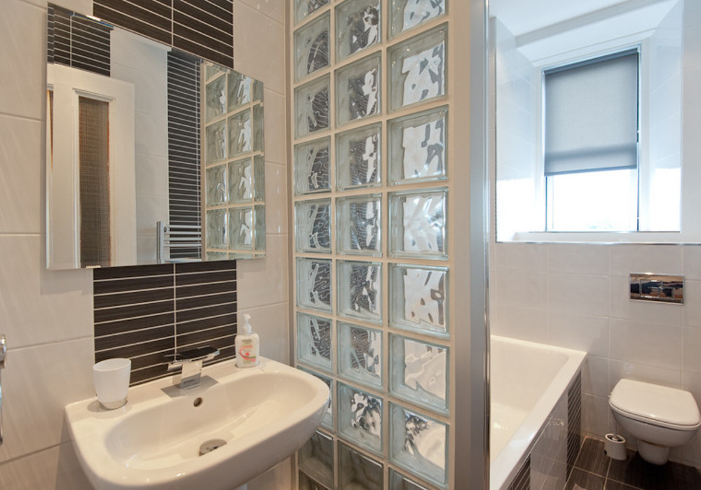 The modern, designer bathroom - On the lower floor of the apartment you'll find this stunning bathroom, featuring a bath with shower over.