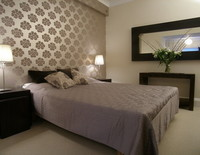 Picture of bedroom in York Place Studio, Lothian, Scotland - Relax and have a wonderful night's sleep in this sumptous king size bed.