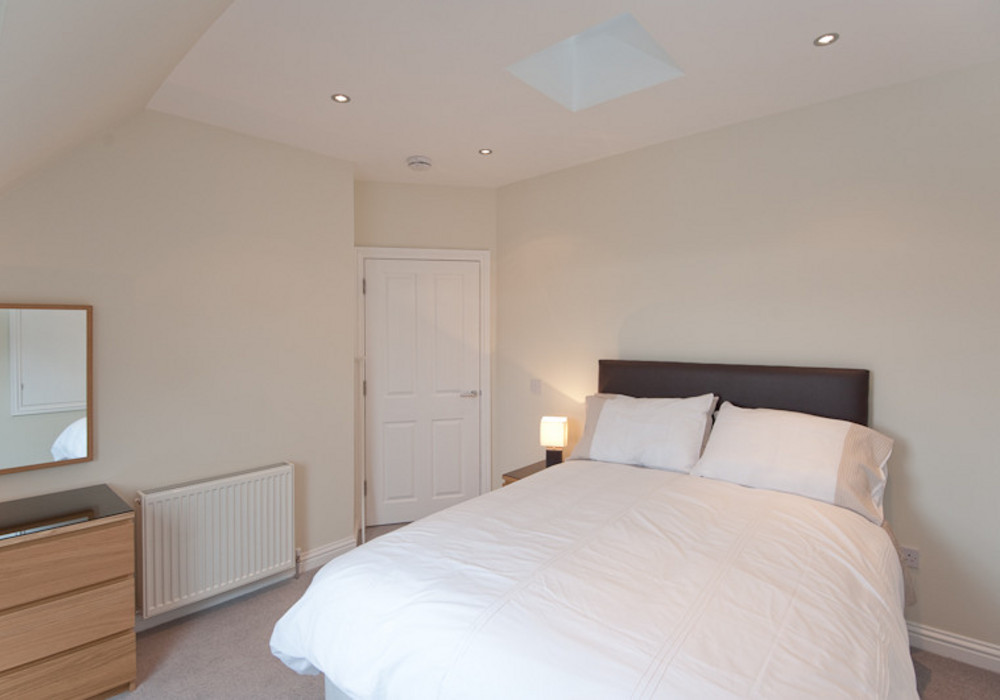 Upstairs double bedroom - A spacious room featuring a fixed double bed.