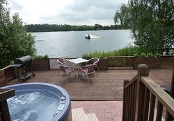 Hot tub with fabulous lake views  - Where better to relax have a glass of wine, a cool beer or a refreshing cuppa than on the wonderful terrace or in the hot tub with fabulous views over the water-ski lake. ( lux lodge holidays )