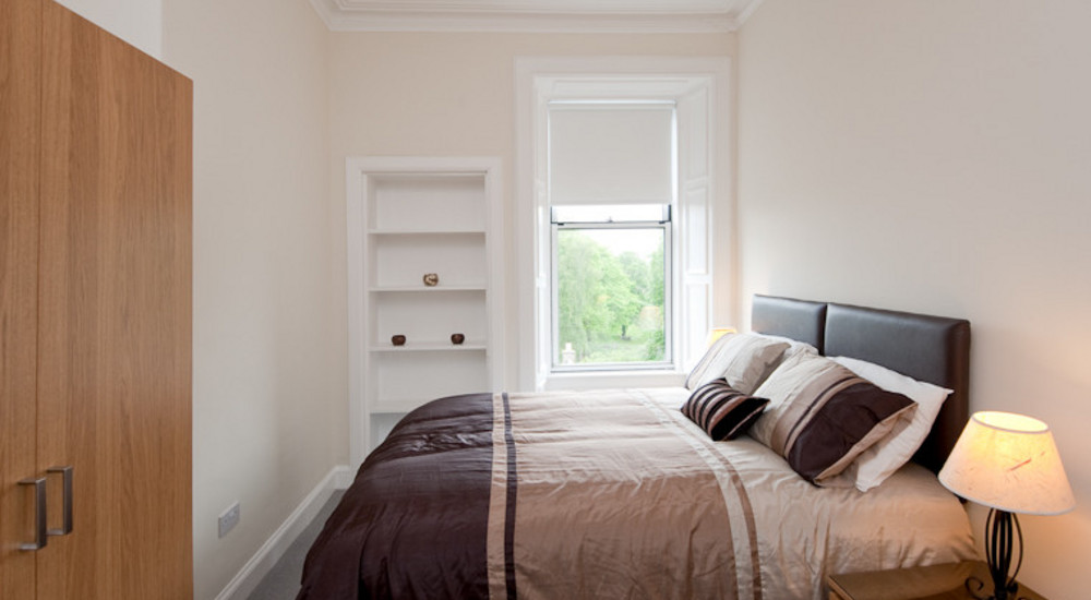 The second lower floor bedroom - Featuring a double bed which can be seperated, allowing the room to be set up as a twin (two single beds) if required. This room also benefits from views out across the park.