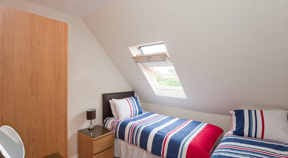 One of the upper floor bedrooms - Seen here with the optional additional pull-out bed set-up ready for your stay.